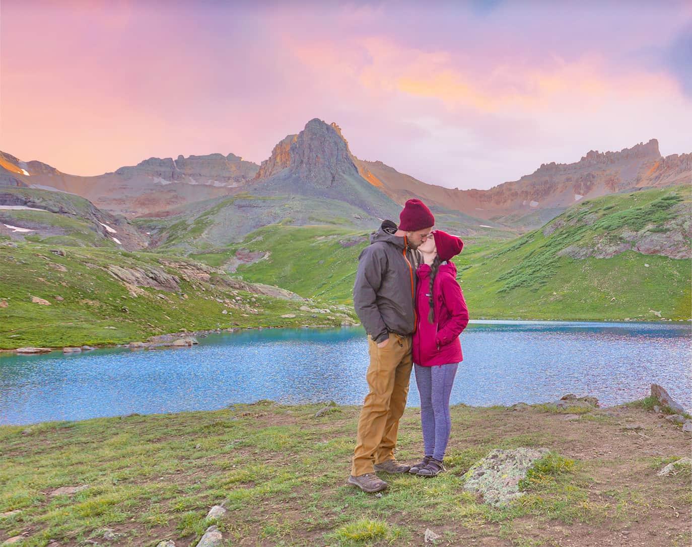 couple kissing at ice lake basin at sunset
